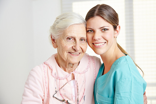 Female nurse caring for elderly woman